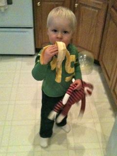 Noah and Monkey eating a banana